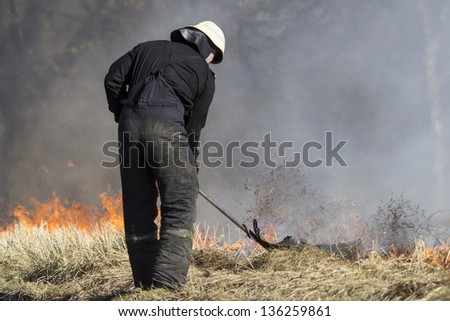 Firefighters extinguishing fire - stock photo