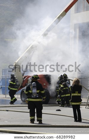 Firefighters extinguishing fire in building - a series of FIRE images. - stock photo