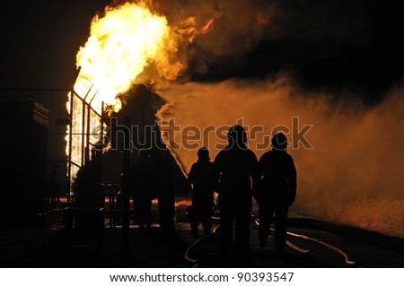 firefighters in action after a gas explosion - stock photo
