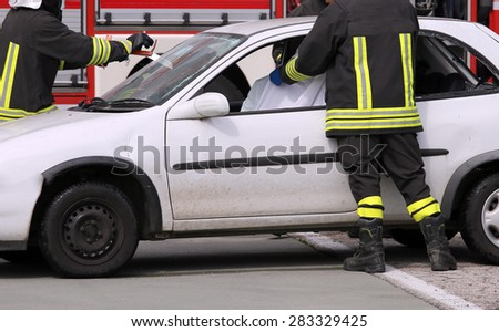 firefighters in action after the road accident