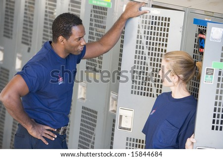 Firefighters in the fire station locker room - stock photo