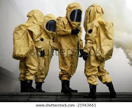 Firefighters in yellow protective equipment