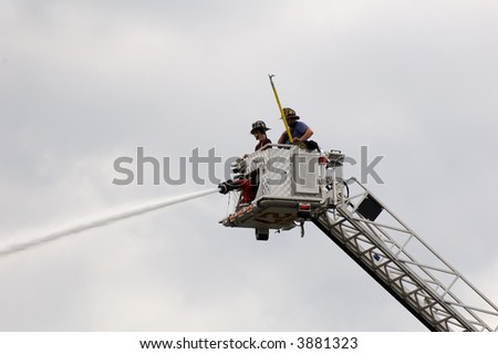 firefighters on tower - stock photo