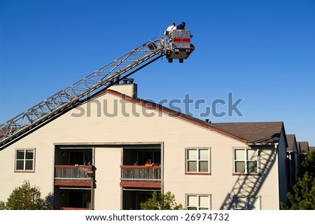 Firefighters performing roof and chimney inspection - stock photo