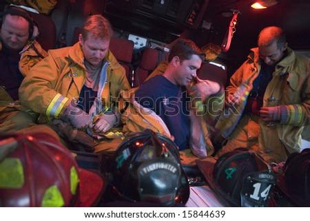 Firefighters preparing for an emergency situation - stock photo