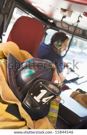 Firefighters travelling to an emergency - stock photo