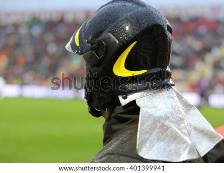 firefighters with hardhat in riot gear during the sports event at the stadium