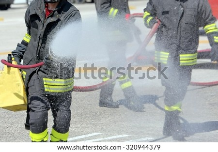 firefighters with the fire extinguisher during a practice session at Firehouse