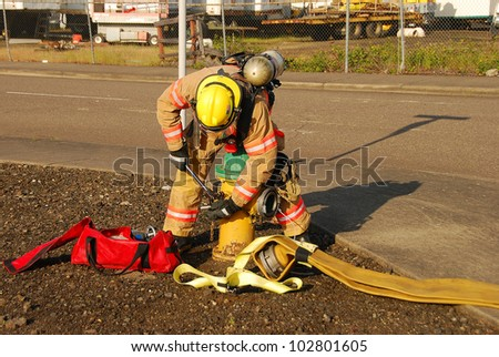 Firefighters working at a potential fire in a industrial site - stock photo