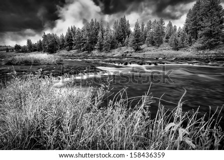 Firehole River in Yellowstone National Park under ominous fall skies - stock photo