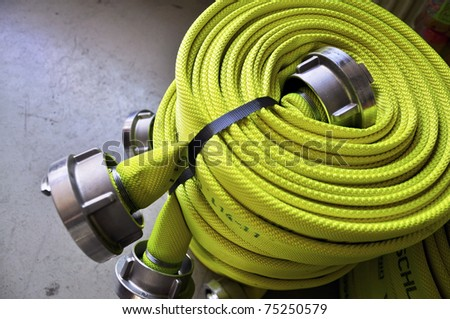 Firehose, rolled up to be used by Firefighters - stock photo