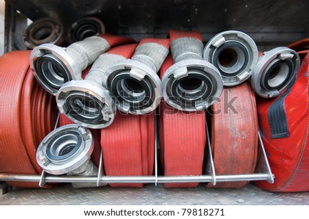 Firehoses and other equipment in a truck to be used by firefighters - stock photo
