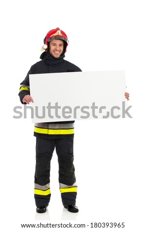 Fireman announcement. Smiling fireman in red helmet standing with blank banner. Head and shoulders studio shot isolated on white. - stock photo