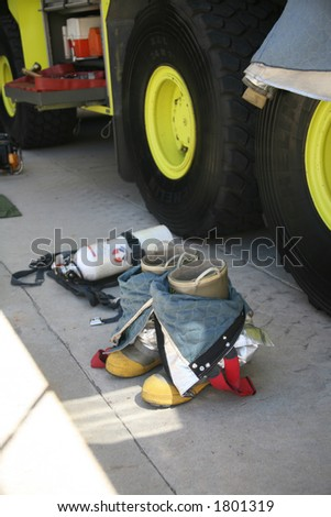 Fireman Boots on Pavement - stock photo