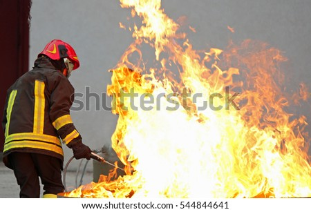 fireman during a training exercise off a huge fire in the brazier