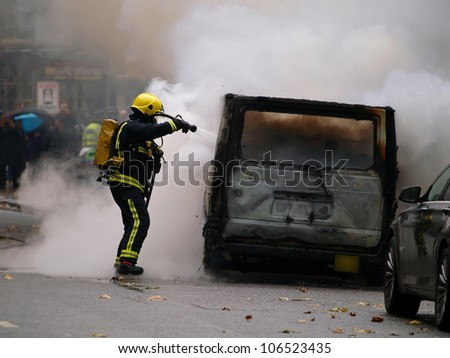 fireman fighting with the fire on the burning van