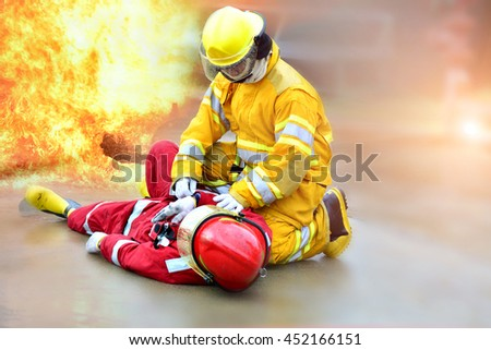 Fireman get accident in action at work. - stock photo