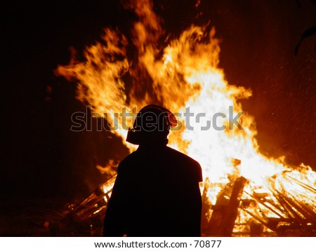 Fireman in front of a large fire