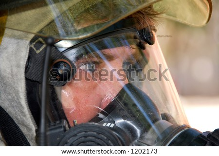 Fireman in protective equipment - stock photo