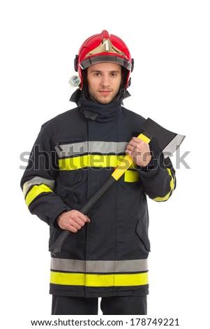 Fireman in red helmet holding axe. Three quarter length studio shot isolated on white.  - stock photo
