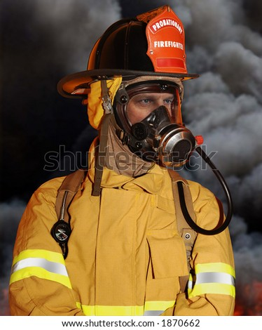 fireman on location with smoke in background - stock photo