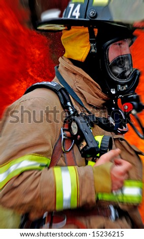 Fireman rushing to scene of large fire - stock photo