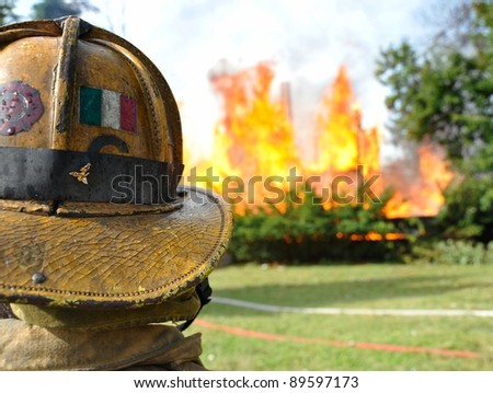 fireman wearing helmet at residential fire - stock photo