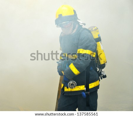 Fireman working in a fire place - stock photo