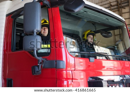Firemans on duty,under ehposed photo - stock photo
