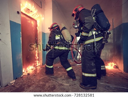 Firemans team during firefighting