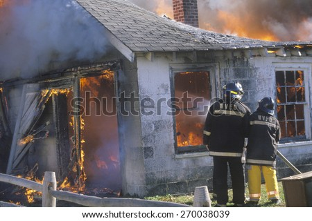 Firemen putting out a house on fire, West Virginia