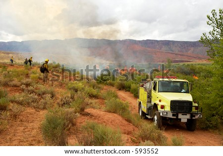 Firemen watch over a prescribed burn on public land in the high desert of Utah.