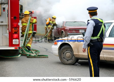 firemen with burning car