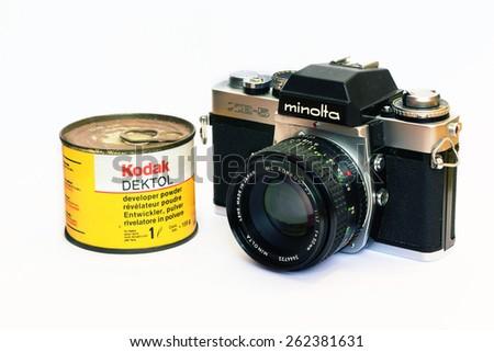 Firenze, IT - March 20, 2015: Vintage Minolta XE-5 reflex film camera and Kodak Dektol developer powder for print, 1971 - stock photo