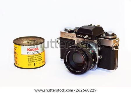 Firenze, IT - March 20, 2015: Vintage Minolta XE-5 reflex film camera with Kodak Dektol developer powder for print - stock photo
