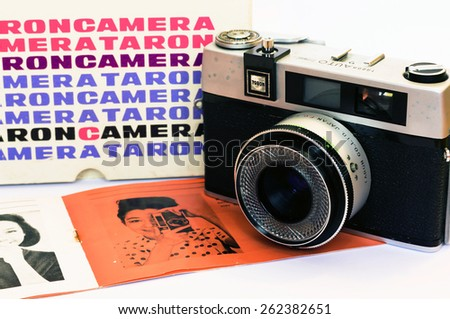 Firenze, IT - March 20, 2015: Vintage Taron 50mm film camera with instruction manual and original case - stock photo