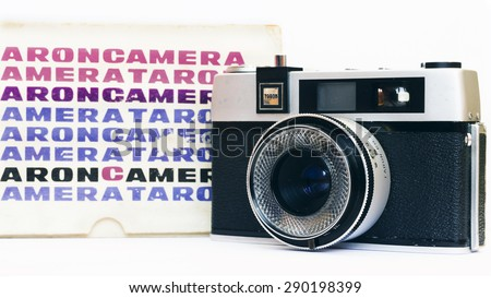 Firenze, IT - March 20, 2015: Vintage Taron 50mm film camera with instruction manual and original case. - stock photo