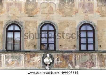 FIRENZE, ITALY - MAY 22, 2014 - Facade of house is decorated with wall paintings