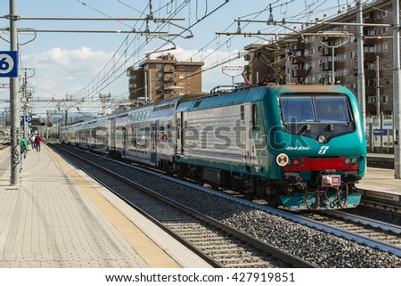 FIRENZE- ITALY: MAY, 5 2016: Trenitalia Regional Passenger train with E464 Electric Locomotive is Arriving at the Station of Firenze Rifredi.