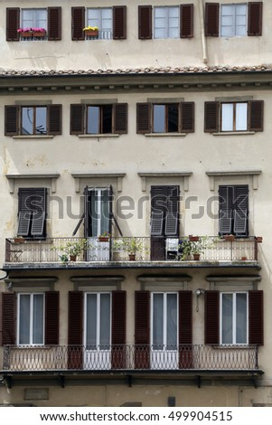 FIRENZE, ITALY - MAY 22, 2014 - Typical facade with windows of Tuscan architecture.