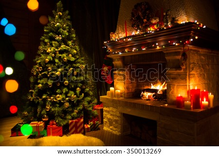 fireplace and decorated Christmas tree un Living room - stock photo