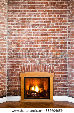 Fireplace and Flat Brick Wall Perspective Perfect for Painting or Picture Frame Addition - stock photo