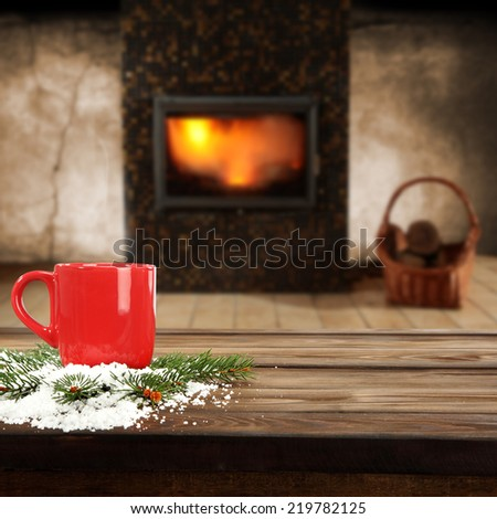 fireplace and red mug