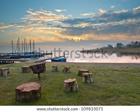 Fireplace at the shore of a lake - stock photo