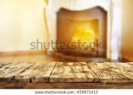 fireplace background and shabby dirty old table and room place  - stock photo