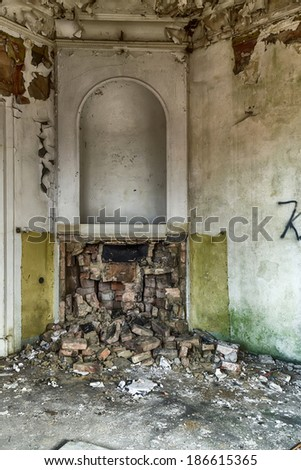 Fireplace damaged an abandoned house - stock photo