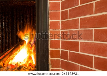 Fireplace, detail of home interior. - stock photo