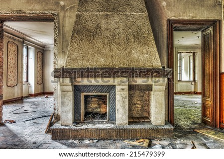 Fireplace in an abandoned manor, HDR - stock photo