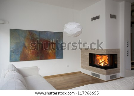 Fireplace in bright and contemporary living room - stock photo