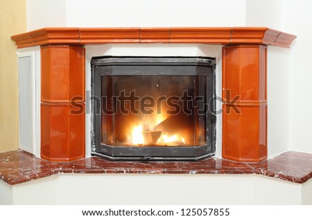 Fireplace in house interior - stock photo